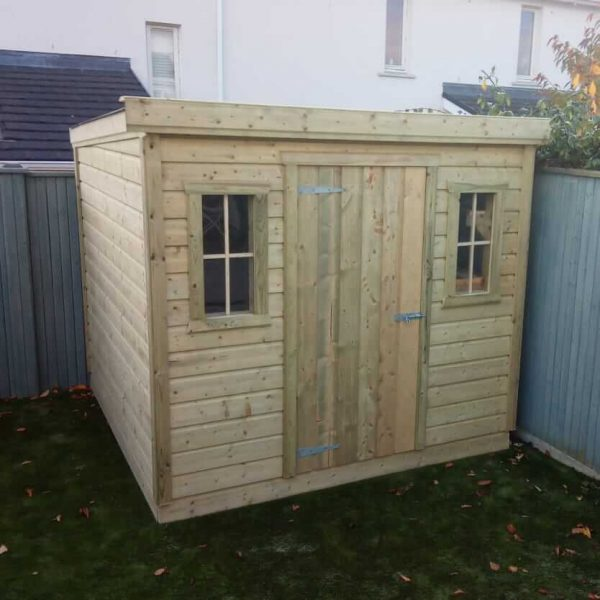 An 8x6 Pent Shed in a Green back Garden