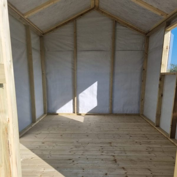 The internal gable side of an apex roofed shed
